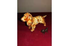 Cold painted Austrian Bronze Spaniel with miniature terrier